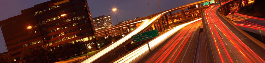 time-lapse photo of freeway interchange at night
